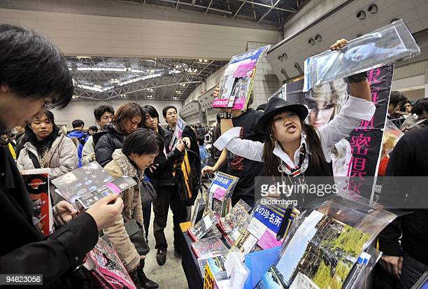 Vendor attracts visitors to her booth at the bi-annual Comic Market in Tokyo, Japan, on Saturday, Dec. 29, 2007. More than 35,000 groups of amateurs...