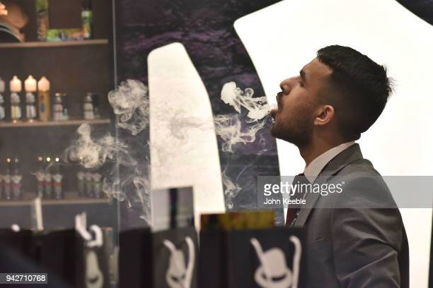 A vendor blows smoke rings during the Vape Jam UK 4 at ExCel on April 6 2018 in London England Vape Jam UK the premier Electronic Cigarette and...