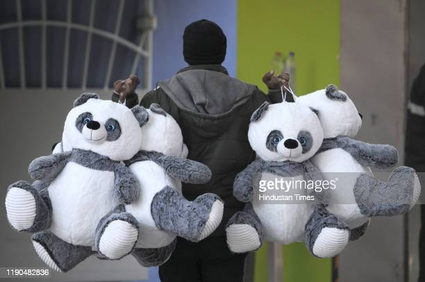 A vendor carries teddy bears for sale during Christmas celebration in Sector 38A on December 25 2019 in Noida India