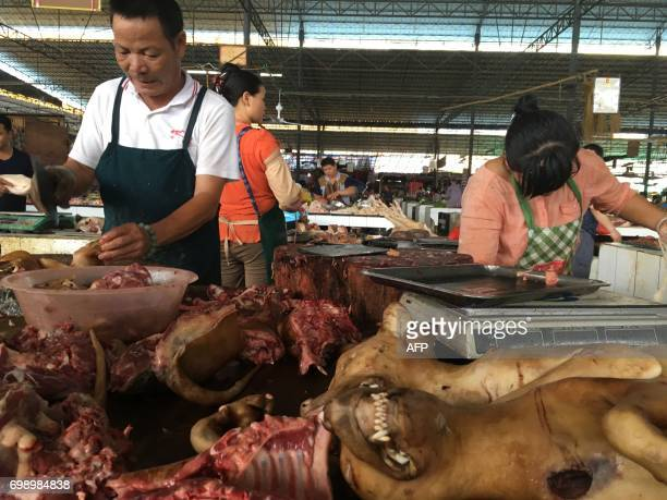 A vendor chops dog meat at the Nanqiao market in Yulin in China's southern Guangxi region on June 21 2017 China's most notorious dog meat festival...