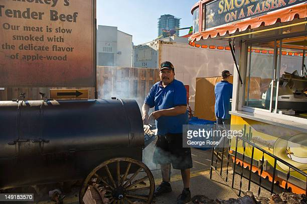 A vendor cooks during the calgary Stampede on July 6 2012 in Calgary Canada Calgary Stampede the world's largest outdoor event featuring a world...