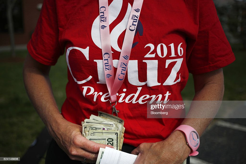 A vendor counts cash after selling merchandise outside a campaign event for Senator Ted Cruz, a Republican from Texas and 2016 presidential candidate, in Borden, Indiana, U.S., on Monday, April 25, 2016. Cruz won the majority of delegates that the Utah and Maine parties voted to send to July's convention, another victory for the Texas senator's organizational efforts over front-runner Donald Trump that could bolster Cruz at a contested convention. Photographer: Luke Sharrett/Bloomberg via Getty Images