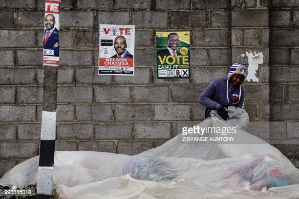TOPSHOT A vendor covers her wares before leaving her stall to attend a Movement for Democratic Change Alliance addressed by opposition leader Nelson...