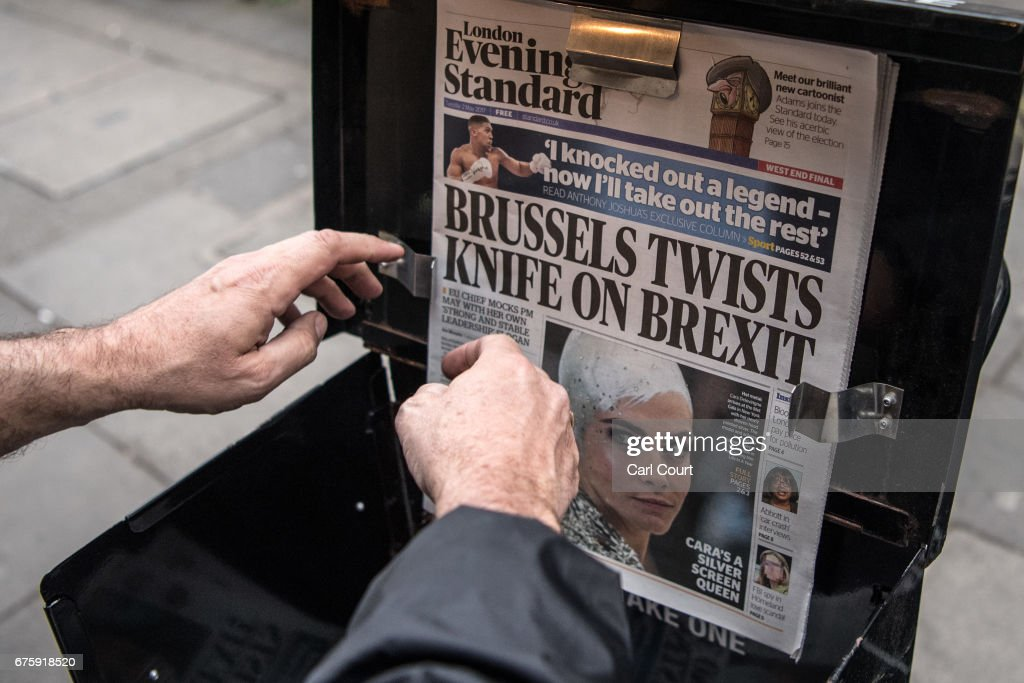 A vendor displays a copy of the Evening Standard newspaper on May 2, 2017 in London, England. Former Chancellor of the Exchequer, George Osborne, today started his first full day as editor of the newspaper having recently announced that he was stepping down from his seat as MP for Tatton following criticism for accepting the position.