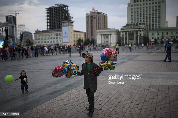 A vendor displays balloons for sale at Sukhbataar Square known as Chinggis Square in Ulaanbaatar Mongolia on Wednesday July 13 2016 The nation's...