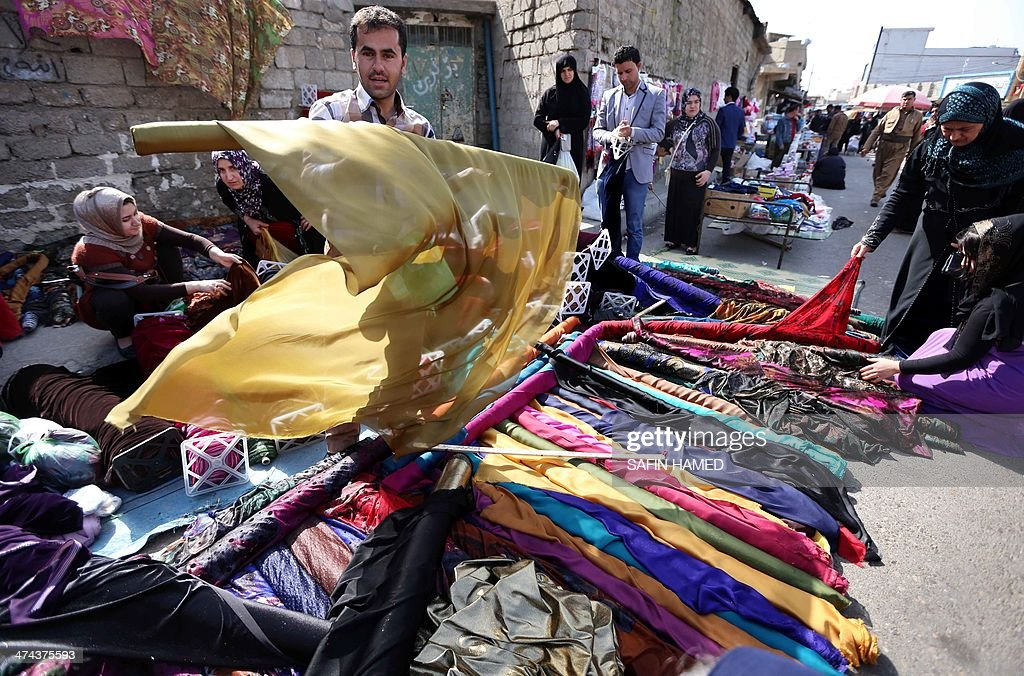 A vendor displays material used for traditional Kurdish
