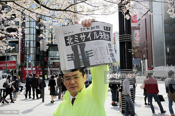 A vendor distributes copies of an extraedition newspaper reporting the launch of a North Korean rocket in Tokyo Japan on Friday April 13 2012 The...