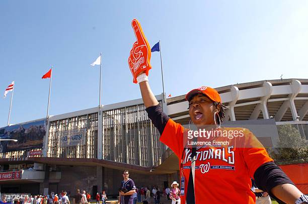 A vendor for the Washington Nationals shouts to fans before their game against the Florida Marlins on Opening Day April 2 2007 at RFK Stadium in...