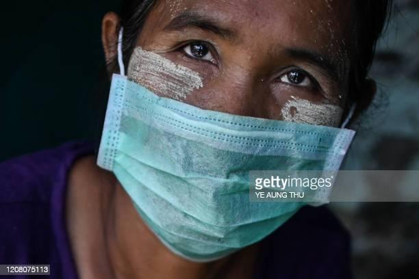 TOPSHOT A vendor having thanaka a traditional facial cosmetic wears a face mask as a preventive measure against the COVID19 novel coronavirus at a...