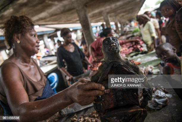 A vendor holds a monkeys head on display with other cuts of bush meat at a market in Mbandaka on May 22 in the Democratic Republic of Congo Health...