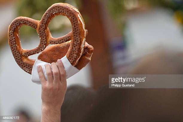 A vendor holds a pretzel at the Hofbraeu tent on the opening day of the 2015 Oktoberfest on September 19 2015 in Munich Germany The 182nd Oktoberfest...