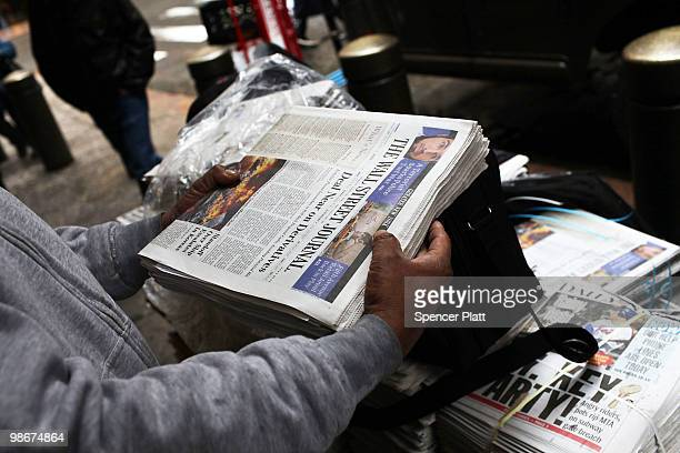 A vendor holds an issue of The Wall Street Journal on April 26 2010 in New York City The Wall Street Journal commenced a New York edition today that...