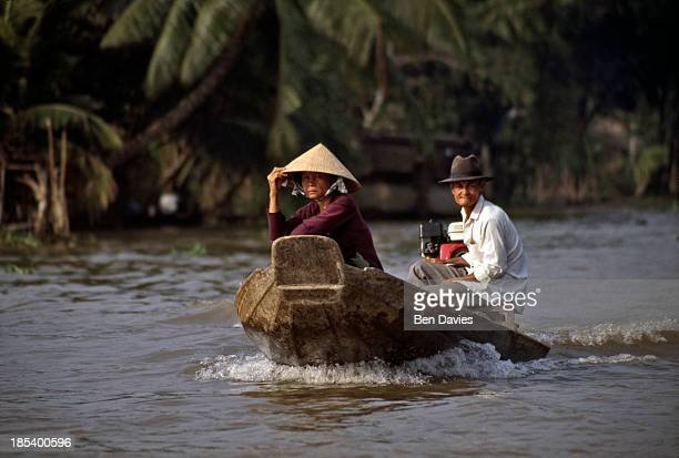 Vendor in a motorized boat heads to Phung Hiep, one of the world's largest floating markets situated at the confluence of seven canals in the Mekong...