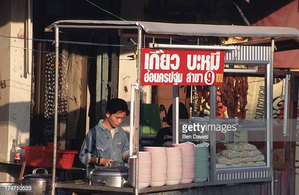 A vendor in a noodle stall sells boiling noodle soup known as withiaw nam to local customers Thai street food is cheap clean and delicious It is...