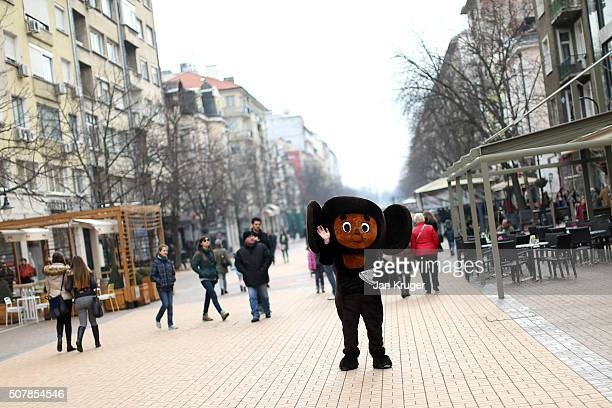A vendor in costume hands out leaflets on January 31 2016 in Sofia Bulgaria