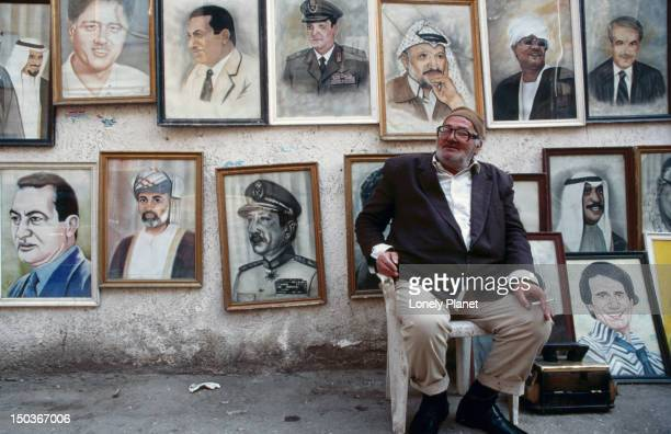 Vendor in front of his world-leaders portraits - Cairo