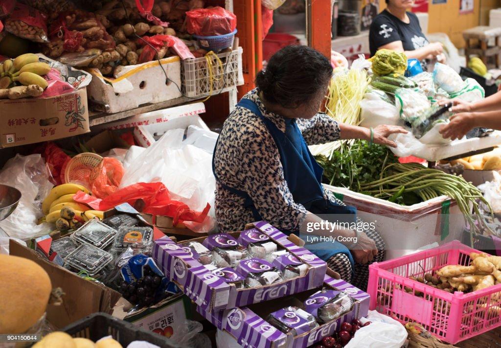 Vendor in Hong Kong market : Stock Photo