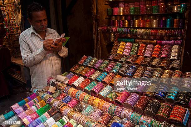 Vendor is selling different types of colourful bangles for women in Kolkata, West Bengal, India.