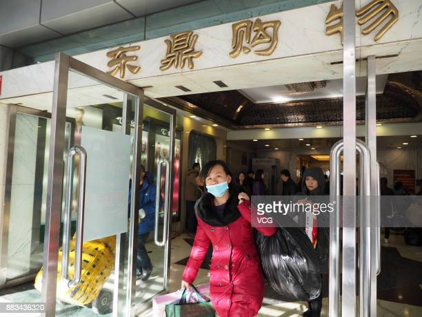 A vendor leaves Dongding wholesale market before its closing on November 30 2017 in Beijing China The Dongding market the last of 12 clothing...