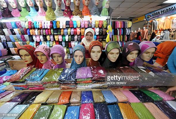 A vendor of headscarfs waits for customers in the 4th day of Ramadan at a market in Jakarta on August 25 2009 During Ramada2009 During Ramadan...