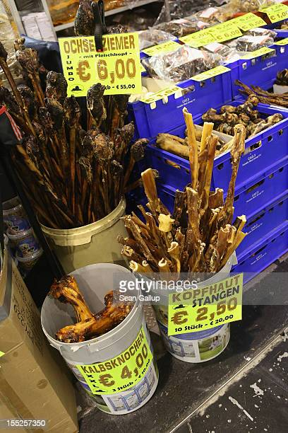 A vendor of snacks for pet dogs sells dried bull penises calf bones head skin rolls and other delights at the pet trade fair at Velodrom on November...