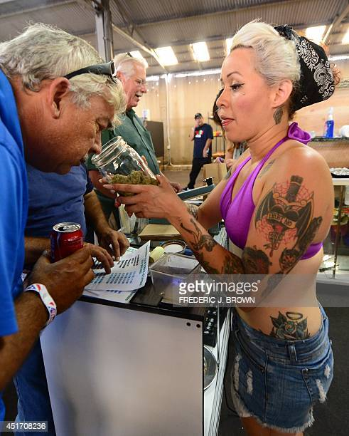 A vendor offers a whiff of the strain 'Skyjack' to cardcarrying medical marijuana patient at Los Angeles' firstever cannabis farmer's market at the...