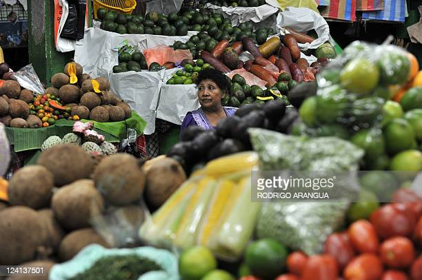 A vendor offers her products at the Central Market of Guatemala City on September 8 2011 Guatemala will hold presidential elections on September 11...