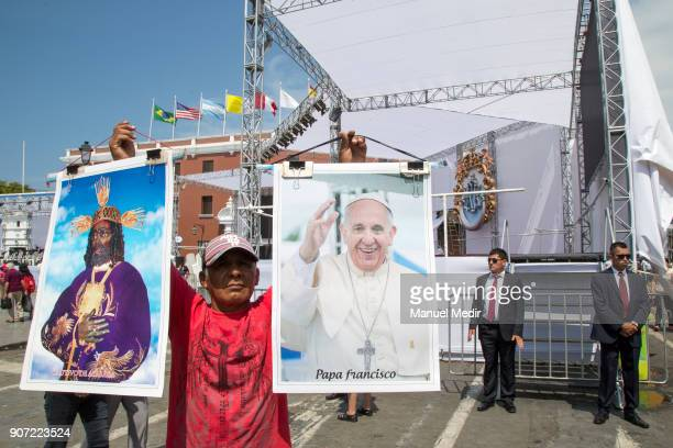 A vendor offers posters with the image of Pope Francis outside Trujillo cathedral during Pope Francis 4day apostolic visit to Peru on January 19 2018...