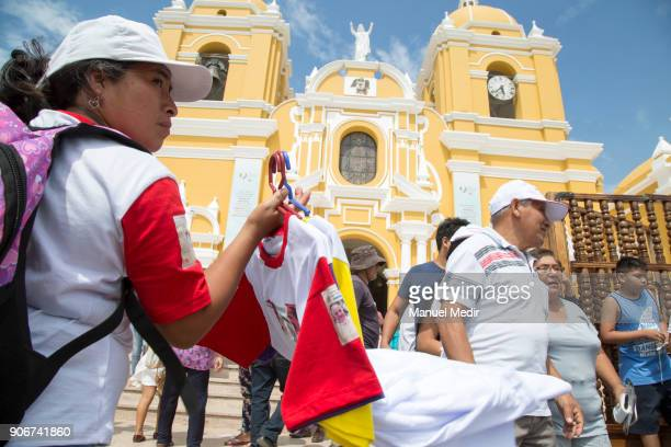 A vendor offers tshirts with the image of Pope Francis outside Trujillo cathedral prior Pope Francis 4day apostolic visit to Peru on January 18 2018...