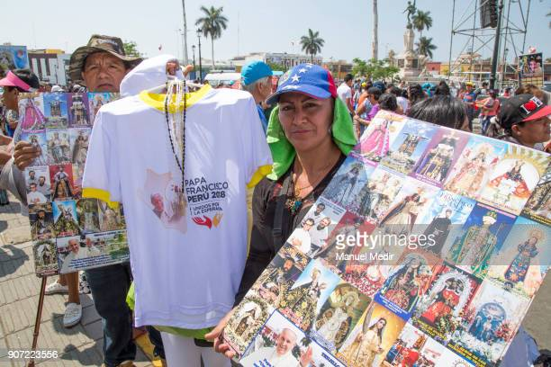 A vendor offers tshirts with the image of Pope Francis outside Trujillo cathedral during Pope Francis 4day apostolic visit to Peru on January 19 2018...