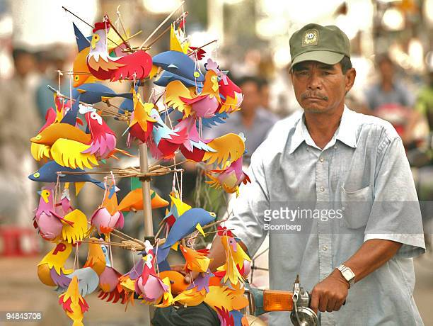 A vendor pedals toys on the streets of Chau Doc Vietnam on November 21 2005 Vietnam which had initially hoped to join the WTO by the end of 2005 no...