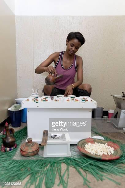 Vendor pouring Ethiopian Coffee