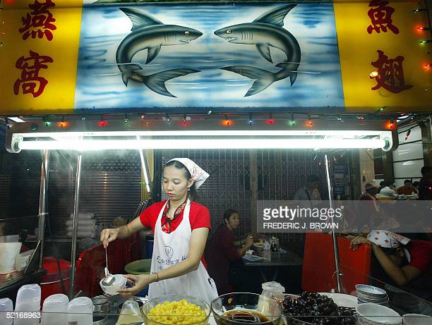 Vendor prepares a bowl of soup at a stall serving shark's fin soup and other Chinese delicacies, late 09 February 2005 in Bangkok's Chinatown, as...