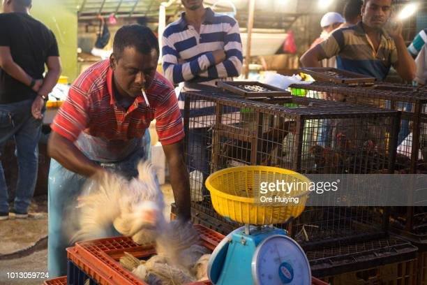A vendor prepares a chicken for slaughter in a market on July 30 2018 in Kuala Lumpur Malaysia Malaysia's former prime minister Najib Razak has been...