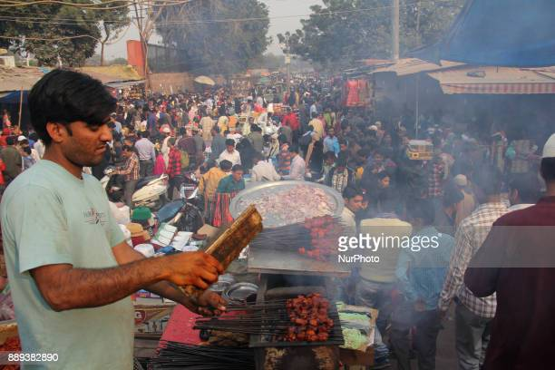 A vendor Prepares Barbecues on the Stairs of Jamia Masjid Old Delhi On Sunday 10th of December 2017