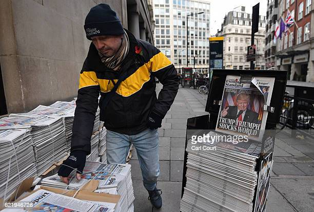 Vendor prepares copies of London's Evening Standard newspaper featuring a photograph and story about U.S President-elect Donald Trump on the front...