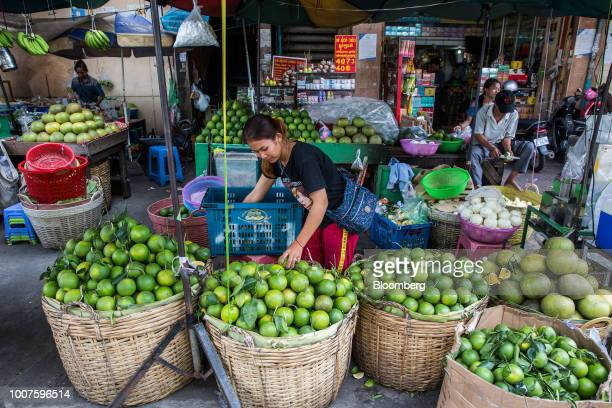 A vendor prepares green oranges at a stall at Orussey Market in Phnom Penh Cambodia on Friday July 27 2018 Cambodian Prime MinisterHun Senextended...