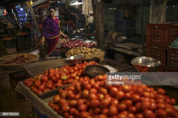 A vendor prepares produce at a stall in Mumbai India on Friday Dec 15 2017 India's inflation surged past the central bank's target bolstering a view...