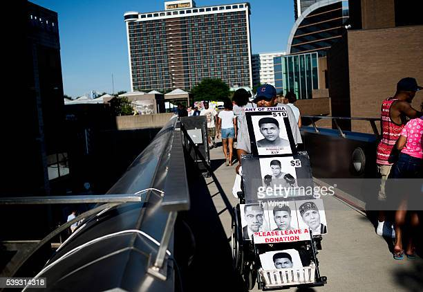 A vendor pushes his cart across the skywalk at the Muhammad Ali Center on June 10 2016 in Louisville Kentucky After the funeral and the eulogy people...