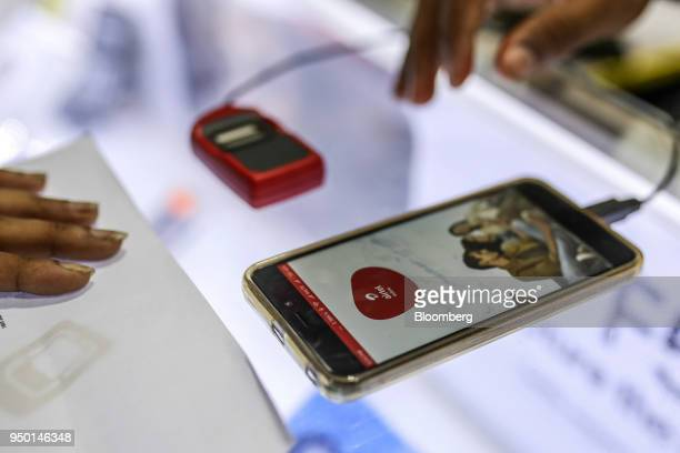 A vendor registers a new data connection on a Bharti Airtel Ltd app for a customer at a store in Mumbai India on Saturday April 21 2018 Bharti Airtel...