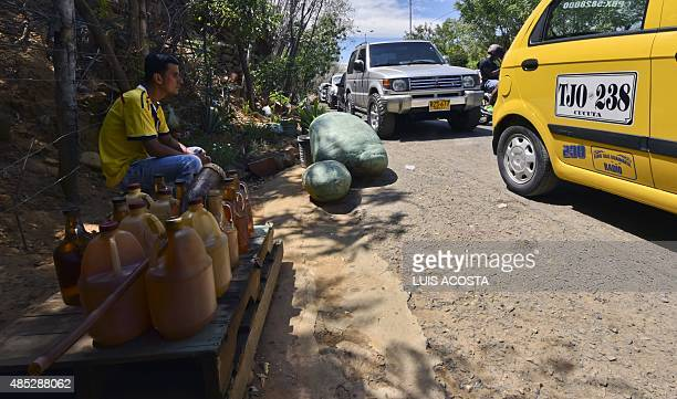 Vendor rests next to bottles with smuggled gasoline in Cucuta, Colombia, in the border with Venezuela on August 26 as the border crisis is causing...