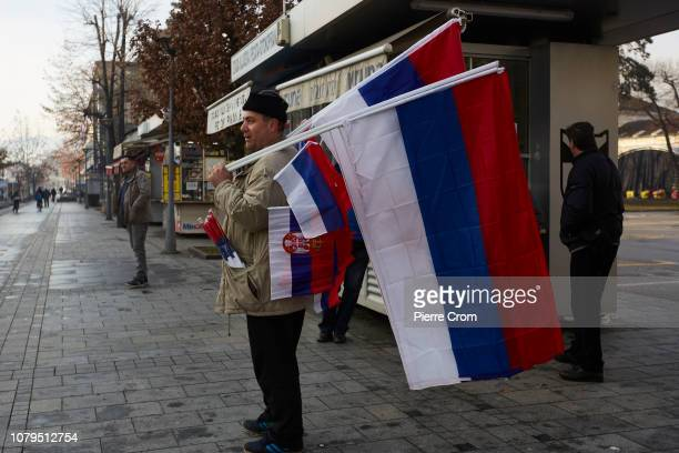 A vendor sales flags prior to the parade in Banja Luka on January 9 2019 in Banja Luka Bosnia and Herzegovina Republika Srpska the Serbian entity of...