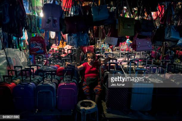 A vendor selling a variety of plastic luggages in a market on April 5 2018 in Manila Philippines The Philippines has been ranked third on the list of...