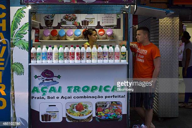 A vendor selling Acai juice waits for customers in the Rocinha favela in Rio de Janeiro Brazil on Thursday Aug 20 2015 With joblessness on the rise...