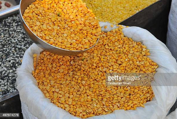 A vendor selling arhar dal pulses at a weekly market on October 16 2015 in Indore India The government today said that it will buy 40000 tonnes of...