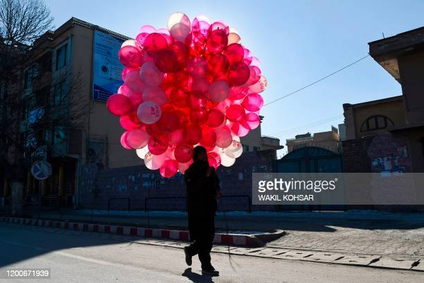 A vendor selling balloons looks for customers along a street on Valentine's Day in Kabul on February 14 2020