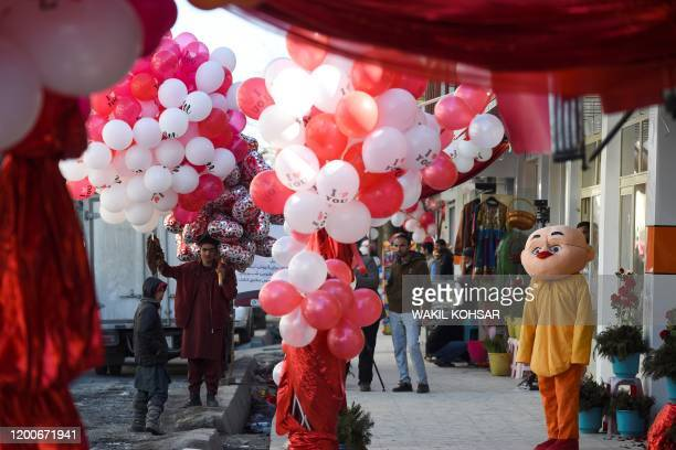 A vendor selling balloons looks for customers on Valentine's Day in the ShareNaw area in Kabul on February 14 2020