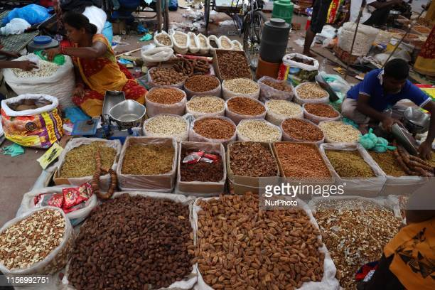Vendor selling Dry fruits wait for the customers in Old Delhi India on 21 July 2019