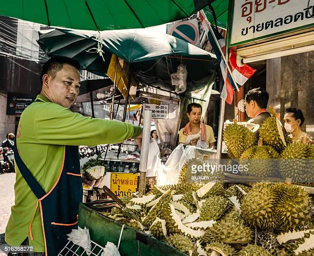 Vendor selling durian fruit Chinatown Bangkok