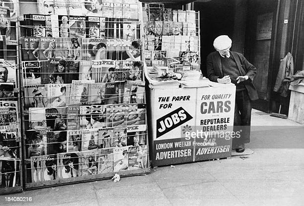 A vendor selling newspapers and pornographic magazines in London 1969